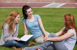 Happy students sitting together